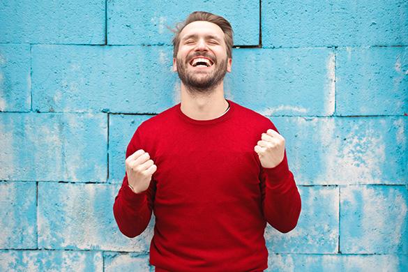 Man smiling wearing red t-shirt
